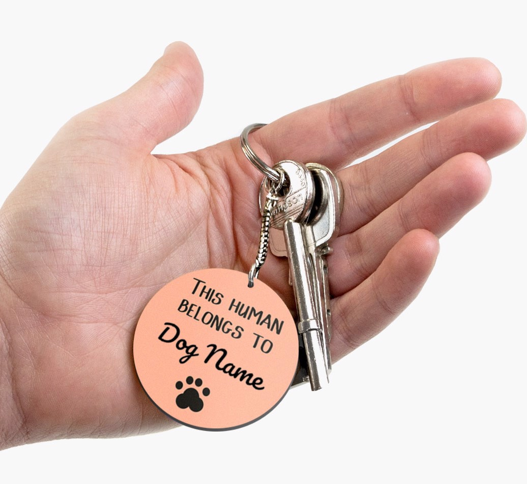 Personalised Dog 'This human belongs to...' Double-sided Keyring Front on hand