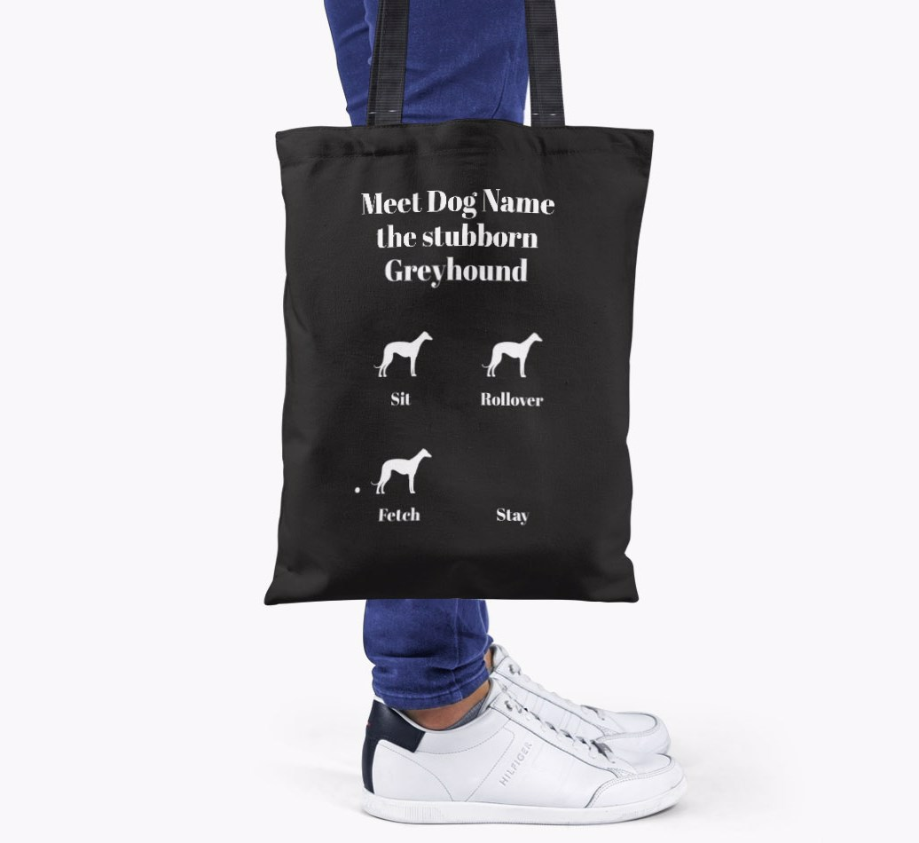 Greyhound All you need is love {colour} shopper bag held by woman